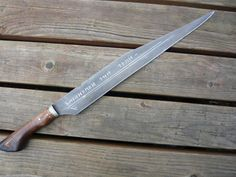 seax with doe-foot hilt ( made by the now split Mad Dwarf Workshop )