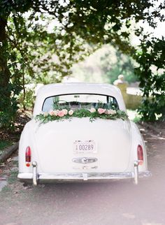 Vintage getaway car: http://www.stylemepretty.com/little-black-book-blog/2016/07/14/style-meets-southern-charm-fashion-floral-filled-bridal-shoot/ | Photography: Julie Paisley - http://www.juliepaisley.com/