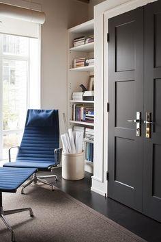 Neutral wall color, dark door, white door trim