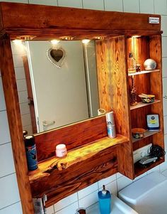 A pallet wood mirror cabinet, does it sound great? this is always a great initiative to make some decent wooden pallet repurposed cabinets indifferent parts of the home because a wooden cabinet is almost needed everywhere inside Wooden Pallet Crafts, Diy Pallet Projects, Wooden Pallets, Pallet Wood, Pallet Ideas, Mirror Cabinets, Wooden Cabinets, Diy Cabinets, Pallet Mirror