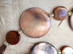 Drops of Jupiter-- Handmade Necklace Featuring Tan Round Shell Beads by ReprievesCorner on Etsy