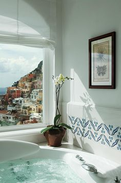 Amazing morning bath with a view of beautiful Greece, maybe? I'd stay for hours...
