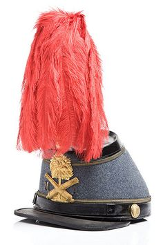 Sumter Guards shako, c. 1875, was worn by R. E. Evans of Charleston. It was made by Baker & McKenney. Charleston Museum.