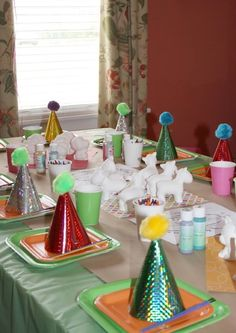 cute art party - balloon topiaries, blank cupcakes to decorate w/sprinkles, ceramics to paint