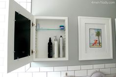 Storage behind a picture frame ... brilliant.  Doesn't have to be limited to the bathroom.