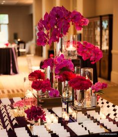 elegant escort card table with pink orchids