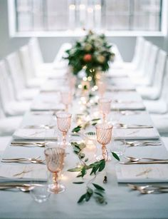 Christmas table with pink glassware and micro fairy lights
