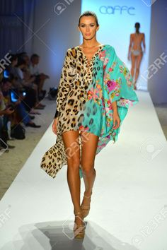 Picture of MIAMI BEACH, FL - JULY A model walks the runway at the Caffe Swimwear show during Mercedes-Benz Fashion Week Swim 2014 at the Raleigh on July 2013 in Miami Beach, Florida stock photo, images and stock photography. Couture Fashion, Boho Fashion, Fashion Beauty, Fashion Outfits, Womens Fashion, African Print Fashion, Fashion Prints, Women's Summer Fashion, Holiday Fashion