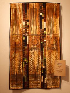 Coffee Country, by Jean Wells. Merit award winning art quilt from the Salem Art Association's show, Bits & Pieces: Intuitive Quilts from the NW and Beyond Seattle and Portland [Oregon] are the coffee capitals of the world. Jean Wells has captured all the lovely shades of coffee drinks here.