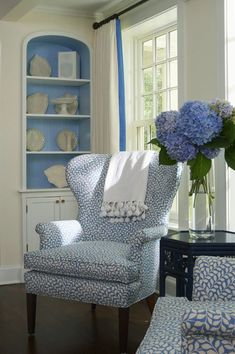 SHELVING: Contrasting paint in back of the bookshelf, and the matching curtain accent.