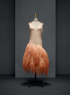 Louiseboulanger (French, 1878–1950) . Evening Dress, 1928, Haute Couture. Machine–sewn, hand–finished beige silk satin, hand–embroidered with natural straw; hand–appliquéd with panels of silk tulle with hand–stitched ombré–dyed ostrich plumes, hand–knotted in strands of three. Photo © Nicholas Alan Cope. #ManusxMachina #CostumeInstitute