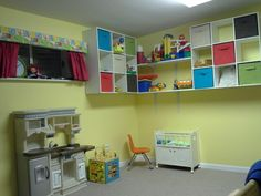 Church nursery - I like the idea of all the toy shelves being off the floor to give more movement space.