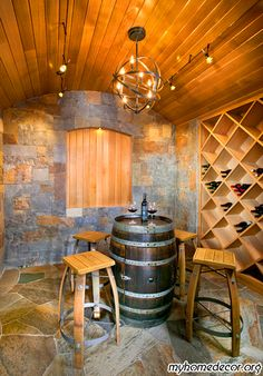 Contemporary Wine Cellar Design...would love to have this...not that I would have enough wine to fill it...I love thr stool made from wooden barrels...I have a whiskey barrel that has been in my father's family for four generation. .