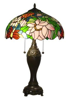 Bring a splash of color and style to your rustic home with this traditional Tiffany-style stained glass table lamp from Amora Lighting. The old world floral design is made of 402 pieces of colored glass and 30 glass gems, creating a truly dazzling effect. Style Floral, Floral Design, Stained Glass Table Lamps, Tiffany Table Lamps, Custom Stained Glass, Buffet Lamps, Lamp Shade Store, Boho Decor, Design Table