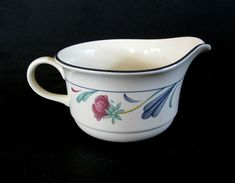 Previously owned in very fine condition. No chips, cracks, crazing or stains. From Lenox a sauce, syrup or gravy boat. The pattern is Poppies On Blue. Made in USA. The diameter is 4 and 7/8th inches excluding the handle. Freezer to Oven to Table, Microwave and Dishwasher safe. No original