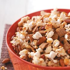 Popcorn Nut Treat Recipe -You need five ingredients to make this special snack mix featuring popcorn, cereal and nuts. The pairing of salty nuts and sweet honey is delicious.