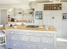 An island isn't just about the work surface: this one is deep enough to house cupboards on the kitchen side and drawers on the entertaining side.