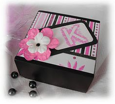 Great idea! Paint a wooden box from any craft store then mod podge some pretty paper and decorate. Super cute!