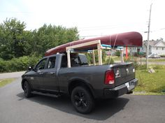 The canoe is tied to the rack AND to the tie down loops in the bed of the truck. We used those spongy things from a car kit to protect the roof of the truck, and we have good tie downs to the tow loops at the front. Nothing moved on this trip.