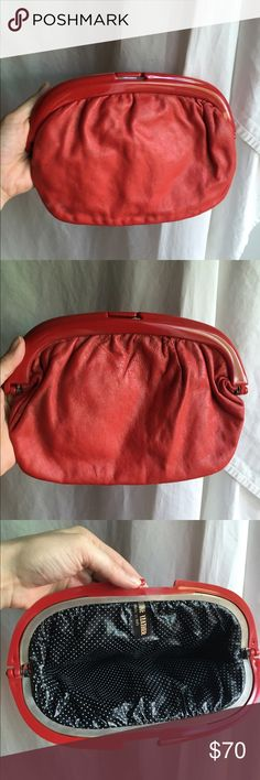 Vintage Red Lucite Clutch Leather Bag Polka Dot Gorgeous vintage real leather clutch with red lucite hinged mouth opening. Plastic polka dot lining. The exterior leather has some small blemishes that are not very visible. Accepting offers! Vintage Bags Clutches & Wristlets