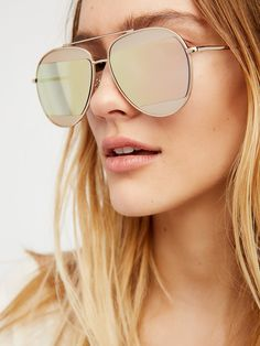 Coast To Coast Aviator Sunnies   Classic aviator style sunnies featuring contrast mirror split lenses. Metal arms and frames.      WARNING: This product contains a chemical known to the State of California to cause cancer and birth defects or other reproductive harm.