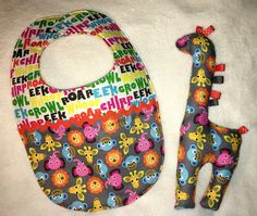 Reversible Bib and stuffed giraffe toy from Pansy Ann's on FB. pansyanns@yahoo.com