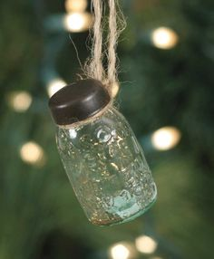 """1¼"""" x 2½"""". Includes jute for hanging. Our popular Mason jar ornament is made of thick recycled glass."""