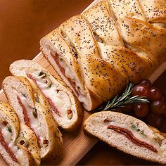 Italian appetizer bread stuffed with salami, cheese and olives makes a perfect warm appetizer for a crowd.