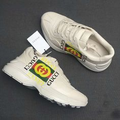 e62c8a70b7607 GUCCI Rhyton Logo print Ivory Distressed Leather Sneakers
