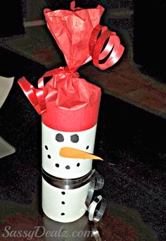 snowman toilet paper roll craft, fill with goodies for a super cute Christmas party favor.