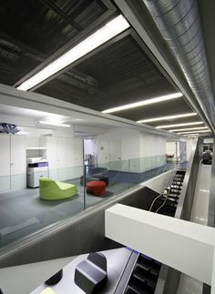 Red Bull office in London, UK - Whooohoooo!!! That's the sound of someone blazing down this new slick carbon slide in the Red Bull office in London right before a meeting #office #workplace carrwoodpark.com