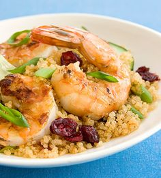 Curried Quinoa Salad with Grilled Shrimp  The shrimp gets a healthy side dish with this recipe. Quinoa, cranberries, scallions, and seasonings make up the nutrient-packed base for this dinner.