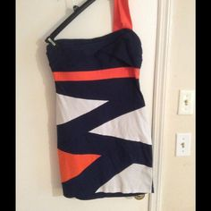 Beautiful dress White navy and orange colored dress. One strap, very flattering. 26 in from armpit to hem in length. Worn once received many compliments fits like a large Dresses