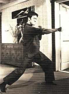 Bruce Lee. Just look at all those muscles popping out of his arm. I would take a body like Bruce's over a body builders any day