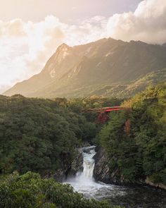 """Maurice Li on Instagram: """"Spending some time on Yakushima, a beautiful island in Southern Japan. Covered with forests and mountains, it's also the wettest place in the country. Waited all day for the rain to subside and then, for five minutes, the sun broke through the clouds and lit up this tiny red bridge and the Torohki-no-taki falls below. @stayandwander"""""""