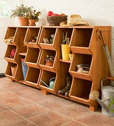 takes garden supplies, potting soil, pet towels and muddy boots in stride, with lots of compartments that are big enough to be useful. Upturned lips keep items stowed. Basement Storage, Garage Storage, Toy Storage, Cubbies, Shelves, New Project Ideas, Organize Your Life, Clever Design, Home Organization