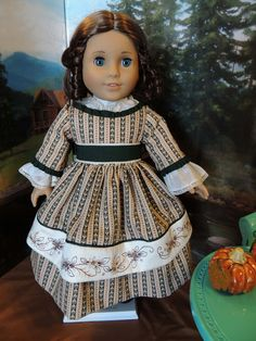 1850's Fall Dress for American Girl Marie-Grace or Cecile. via Etsy.  This is my first dress from RebeccasHeirlooms. I love the green, cream and tan combination. The embroidery is so very pretty. Underneath is a lovely chemise that shows at the neckline and peeks out through the sleeves. Rich feeling cotton fabric. Very, very nice period piece.