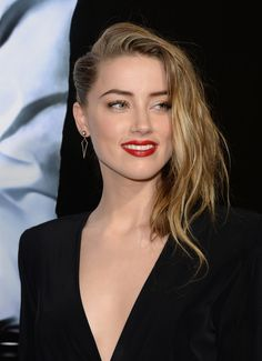 Amber Heard's daring-meets-elegant crimped side sweep and cranberry pucker