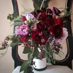 Jennifer's bouquet is so lush and gorgeous!  Deep jewel tones for a winter wedding.