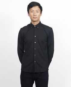 Fresh & modern. Sportswear inspired black button down shirt made from heavy Italian mesh fabric. - spread button collar - rounded buttoned cuffs - front button down closure - 22% poly 22% viscose 2% e