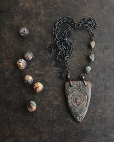 Rustic spiral necklace  - long turquoise and antique gold OOAK ceramic shield necklace