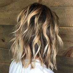 Lived-in dark blonde balayage with a shadow root from True North salon.