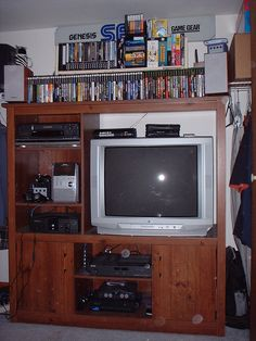 Here's my gaming set up. Everything is crammed most efficiently into my closet. By day it all hides away behind two big folding doors but by night (or mid-afternoon) it is a bustling hive of gaming and/or TV/movie watching. Arcade, Dragon City, Gamer Room, Retro Video Games, Room Goals, Folding Doors, Retro Aesthetic, Consoles, My New Room
