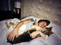 TJ Oshie taking a nap with his dog (Source: @OSH74)