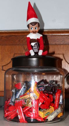 Cuddles got into the candy jar and all I can say is he better not eat it all.... Those Hershey candy bars are MINE!!!!! :)