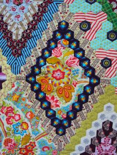 Hexagon Quilts Down Under.  Fussy cut hexagons quilt posted by Karen Griska   Selvage Blog