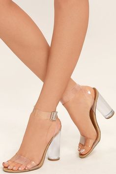 We can totally see you wearing the Steve Madden Clearer Clear Lucite Heels with all of your stylish outfits! Clear lucite forms a slender toe strap, and matching ankle strap that wraps and secures around the ankle with a silver buckle. Nude suede trim completes the look.