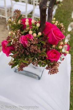 Beautiful floral arrangement for the base of the manzanita trees in silver mirror vase