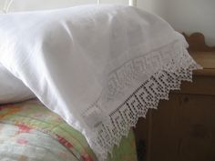 Vintage pillowcase with handmade crochet lace edging