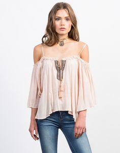 Whether you're heading to the beach or going to a music festival this season, this Cold Shoulder Boho Top will not disappoint. Perfect for the hot weather, pair it with denim shorts and strappy sandals.